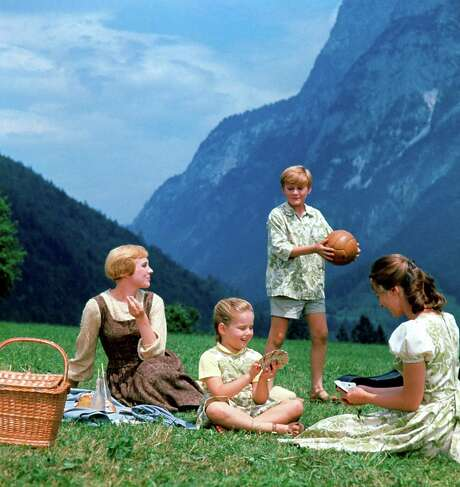 """Maria (Julie Andrews, left), Gretl (Kym Karath), Kurt (Duane Chase) and Liesl (Charmian Carr) sing """"Do-Re-Mi"""" in """"The Sound of Music,"""" a movie that evokes a simpler time but was released in 1965, a period of tumultuous change. Photo: Associated Press / Twentieth Century Fox Home Enter"""