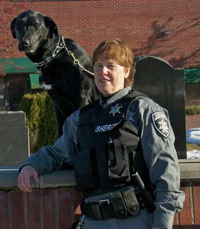K-9 Deputy Sandy Blodgett of the Rensselaer County Sheriff's Office is honored for 30 years of dedicated service. Deputy Blodgett was sworn in as a deputy corrections officer in 1985 and was used in both corrections and highway patrol. In 1988 she was appointed full time to highway patrol and in 1989 became the first female K-9 officer for the sheriff's office. For the past 13 years Blodgett has been one of the leading trainers for the Sheriff's Office and local law enforcement K-9 teams throughout the Capital Region in police tracking and narcotic detection.