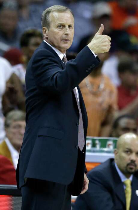 Texas coach Rick Barnes give his team a thumbs-up during the second half of an NCAA college basketball game against Iowa State in the quarterfinals of the Big 12 Conference tournament in Kansas City, Mo., Thursday, March 12, 2015. (AP Photo/Orlin Wagner) Photo: Orlin Wagner, STF / AP