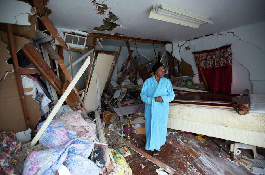 Aggie Meeks awoke early Friday morning to find a pickup truck had plowed into her house - on what was supposed to be the last day of renovations after a car struck the house on Jan. 18. Photo: Cody Duty, Staff / © 2015 Houston Chronicle