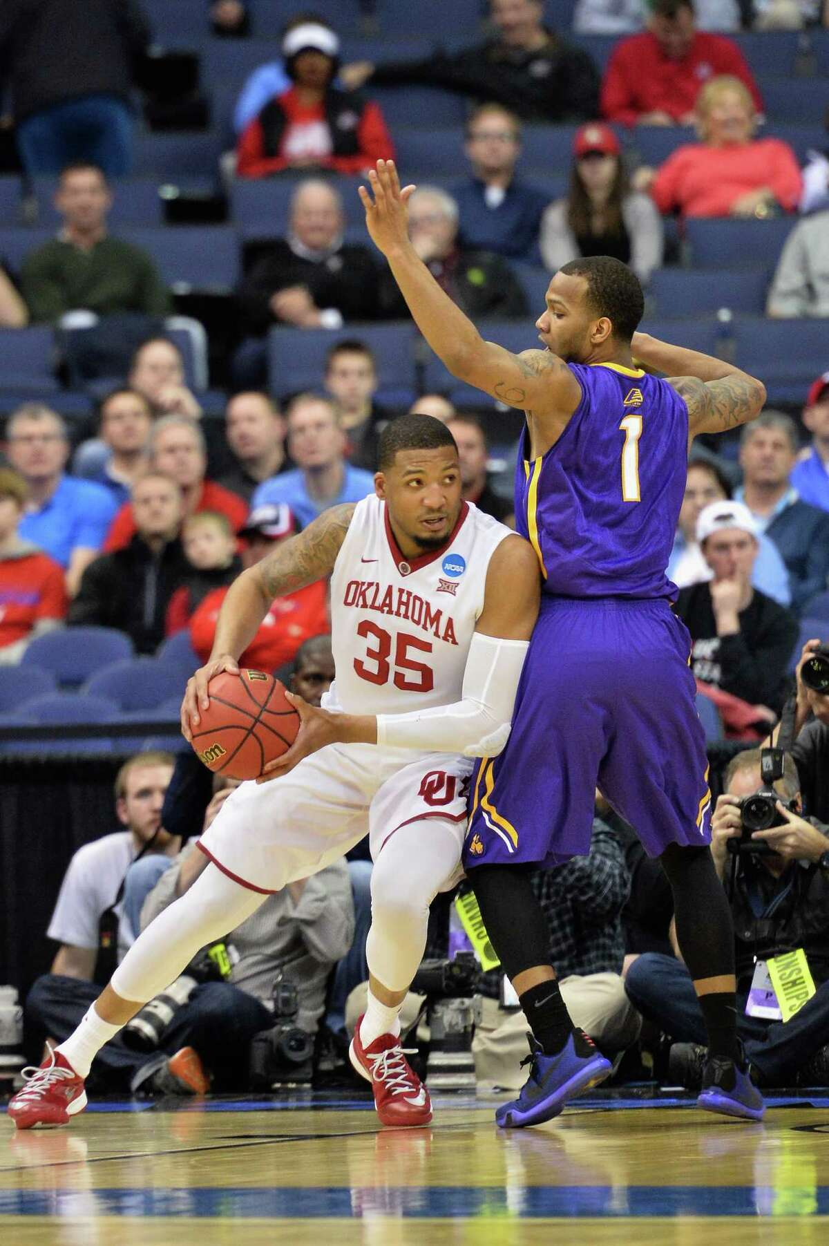 COLUMBUS, OH - MARCH 20: TaShawn Thomas #35 of the Oklahoma Sooners drives against Ray Sanders #1 of the Albany Great Danes during the first half of the second round of the 2015 NCAA Men's Basketball Tournament at Nationwide Arena on March 20, 2015 in Columbus, Ohio. (Photo by Jamie Sabau/Getty Images) ORG XMIT: 527065961