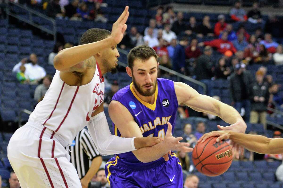 COLUMBUS, OH - MARCH 20: TaShawn Thomas #35 of the Oklahoma Sooners and Sam Rowley #14 of the Albany Great Danes go after the ball during the first half of the second round of the 2015 NCAA Men's Basketball Tournament at Nationwide Arena on March 20, 2015 in Columbus, Ohio. (Photo by Jamie Sabau/Getty Images) ORG XMIT: 527065961