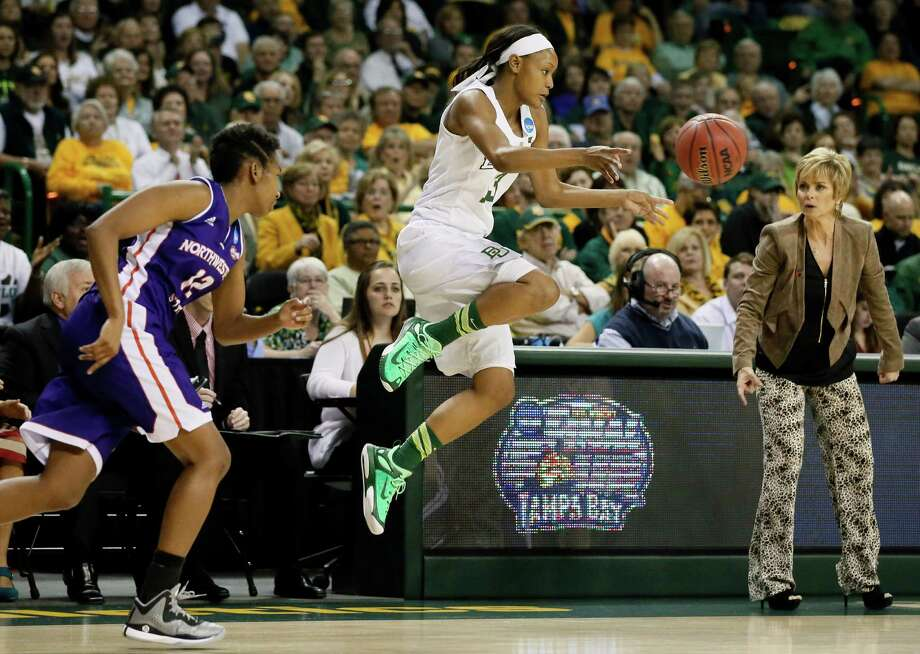 Baylor's Nina Davis, center, beats Northwestern State 's Chelsea Rogers, left, to save the ball from going out of bounds in front of Lady Bears coach Kim Mulkey. Photo: Tony Gutierrez, STF / AP