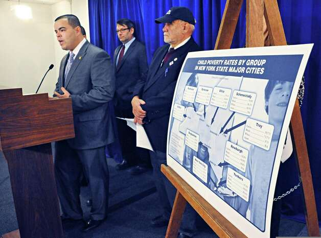 Assemblyman Marcos Crespo, left, decries the high rate of child poverty across the state during a news conference at the LOB Friday March 20, 2015 in Albany, NY.   (John Carl D'Annibale / Times Union) Photo: John Carl D'Annibale / 00031126A