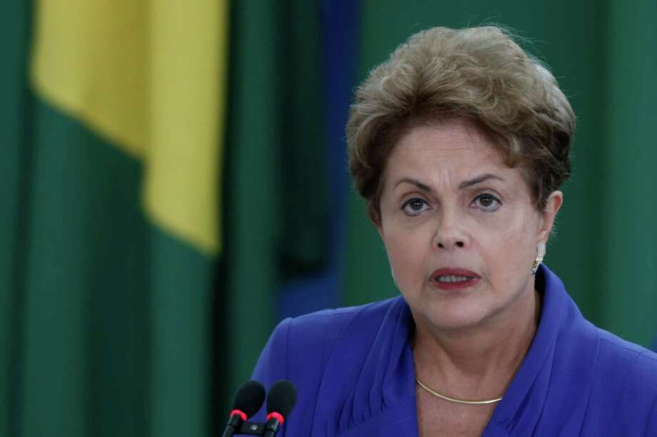 Brazil's President Dilma Rousseff, speaks during ceremony  to introduce an anti-corruption package to Congress in the wake of mass protests calling for an end to graft and her impeachment, at the Planalto Presidential Palace, in Brasilia, Brazil, Wednesday, March 18, 2015. A new poll shows President Rousseff's approval rating plummeted to a new low after Sunday's massive demonstrations protesting against corruption and calling for her impeachment. (AP Photo/Eraldo Peres) Photo: Eraldo Peres, STF / AP