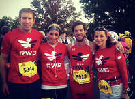 Team Red, White and Blue members from left, Dan Korin, Kristina Braun, Thomas Burke and Tori Guggenheim pose before competing in the Marine Corps Marathon last year in Arlington, Va. Burke and Guggenheim will be participating and volunteering at the 11th Annual Faxon Law Greater Danbury Half Marathon & 5k on March 29 to help raise money for Team RWB, which helps military veterans when they return home from active duty.