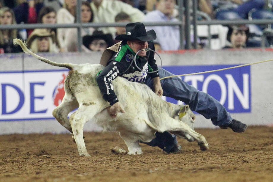 Josh Peek prepares to rope a calf in the wild-card tie-down competition at the Houston Livestock Show and Rodeo at NRG Stadium on Friday night. Photo: Karen Warren, Staff / © 2015 Houston Chronicle