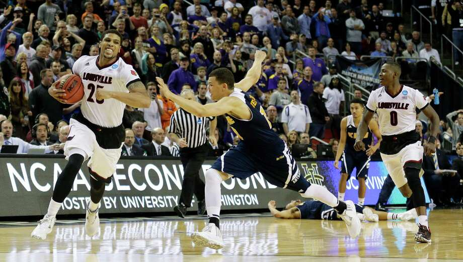 Louisville's Wayne Blackshear, left, runs out the clock after teammate Terry Rozier, right, made the key steal to prevent Luke Nelson and UC Irvine from getting a final shot at an upset of the Cardinals on Friday. Photo: Ted S. Warren, STF / AP