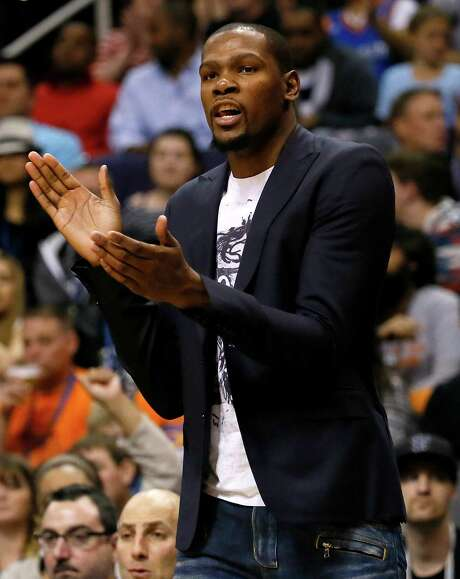 Oklahoma City Thunder forward Kevin Durant cheers on his teammates from the bench during the first half of an NBA basketball game against the Phoenix Suns, Thursday, Feb. 26, 2015, in Phoenix. (AP Photo/Matt York) Photo: Matt York, STF / AP