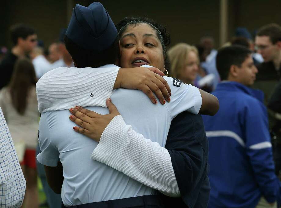 Misty Pettway of Connecticut hugs stepdaughter Airman Arlene Pettway after the graduation ceremony at Lackland. Photo: Photos By Bob Owen / San Antonio Express-News / © 2015 San Antonio Express-News