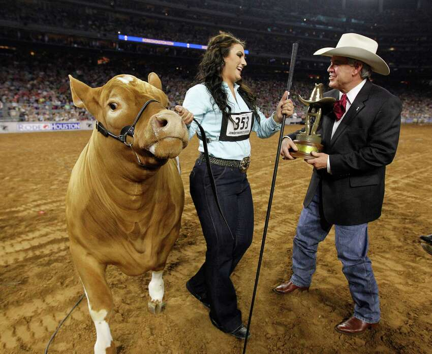 Caitlen Hope Doskocil and Peaches accept the award for grand champion steer at the Houston Livestock Show and Rodeo at NRG Stadium on Friday.