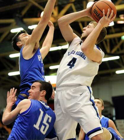 Lake George's Joel Wincowski, right, goes to the hoop during their Class C State boys basketball semifinal against Haldane on Friday, March 20, 2015, at Glens Falls Civic Center in Glens Falls, N.Y. (Cindy Schultz / Times Union) Photo: Cindy Schultz / 10031107A