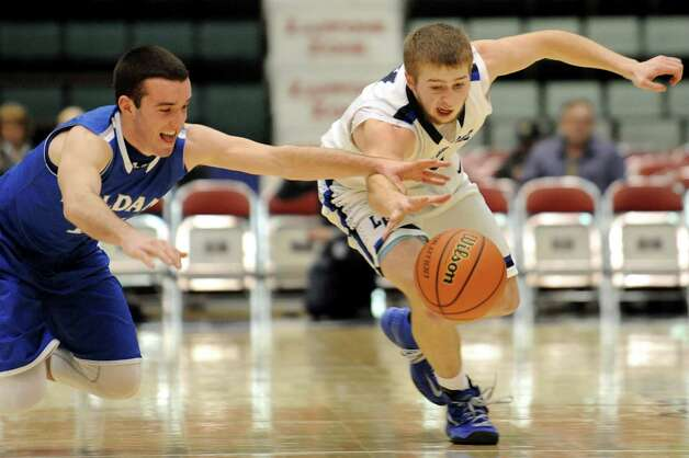 Lake George's Joel Wincowski, right, and Haldane's Ryan McCollum chase a loose ball during their Class C State boys basketball semifinal on Friday, March 20, 2015, at Glens Falls Civic Center in Glens Falls, N.Y. (Cindy Schultz / Times Union) Photo: Cindy Schultz / 10031107A