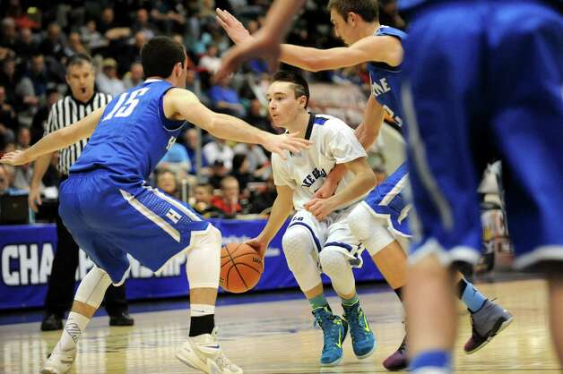 Lake George's Dylan Hubbard, center, runs into heavy traffic during their Class C State boys basketball semifinal against Haldane on Friday, March 20, 2015, at Glens Falls Civic Center in Glens Falls, N.Y. (Cindy Schultz / Times Union) Photo: Cindy Schultz / 10031107A