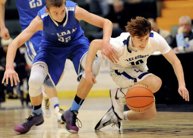Lake George's Craig Keenan, right, and Haldane's Edmund Fitzgerald chase a loose ball during their Class C State boys basketball semifinal on Friday, March 20, 2015, at Glens Falls Civic Center in Glens Falls, N.Y. (Cindy Schultz / Times Union) Photo: Cindy Schultz / 10031107A