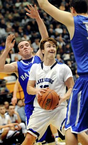 Lake George's Craig Keenan, center, looks for room to shoot as Haldane's Ryan McCollum, left, and Garret Quigley defend during their Class C State boys basketball semifinal on Friday, March 20, 2015, at Glens Falls Civic Center in Glens Falls, N.Y. (Cindy Schultz / Times Union) Photo: Cindy Schultz / 10031107A