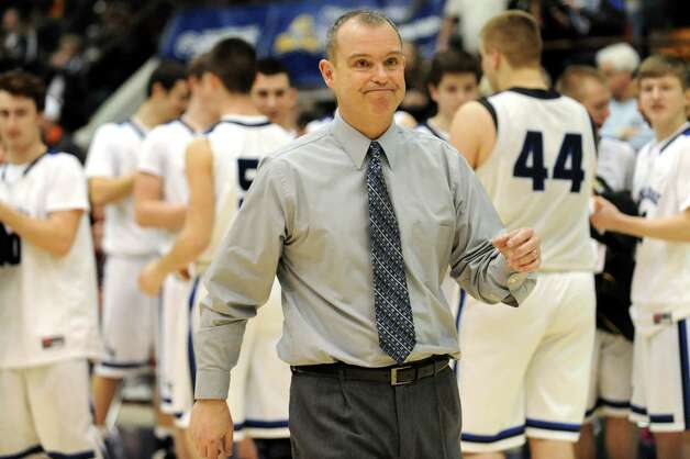 Lake George's coach David Jones, center, is recognized following their Class C State boys basketball semifinal win over Haldane on Friday, March 20, 2015, at Glens Falls Civic Center in Glens Falls, N.Y. (Cindy Schultz / Times Union) Photo: Cindy Schultz / 10031107A