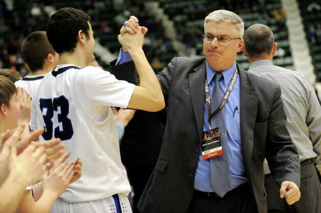 Lake George's assistant coach Tim Kassane, right, and Duncan Mularz celebrate their Class C State boys basketball semifinal win over Haldane on Friday, March 20, 2015, at Glens Falls Civic Center in Glens Falls, N.Y. (Cindy Schultz / Times Union) Photo: Cindy Schultz / 10031107A