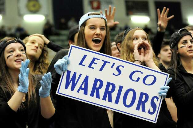 Lake George students cheer for their team during the Class C State boys basketball semifinal against Haldane on Friday, March 20, 2015, at Glens Falls Civic Center in Glens Falls, N.Y. (Cindy Schultz / Times Union) Photo: Cindy Schultz / 10031107A