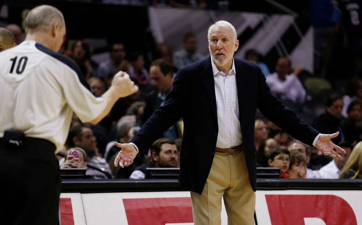 Spurs coach Gregg Popovich talks to official Ron Garretson (10) during their game against the Boston Celtics at the AT&T Center on Friday, Mar. 20, 2015. Spurs win against the Celtics, 101-89. (Kin Man Hui/San Antonio Express-News)