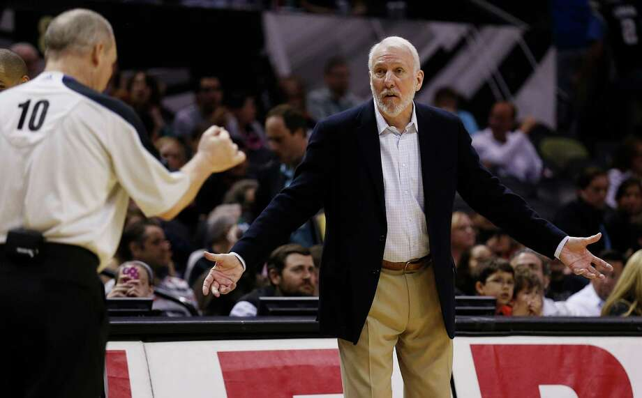 Spurs coach Gregg Popovich talks to official Ron Garretson (10) during their game against the Boston Celtics at the AT&T Center on Friday, Mar. 20, 2015. Spurs win against the Celtics, 101-89. (Kin Man Hui/San Antonio Express-News) Photo: Kin Man Hui, Staff / San Antonio Express-News / ©2015 San Antonio Express-News