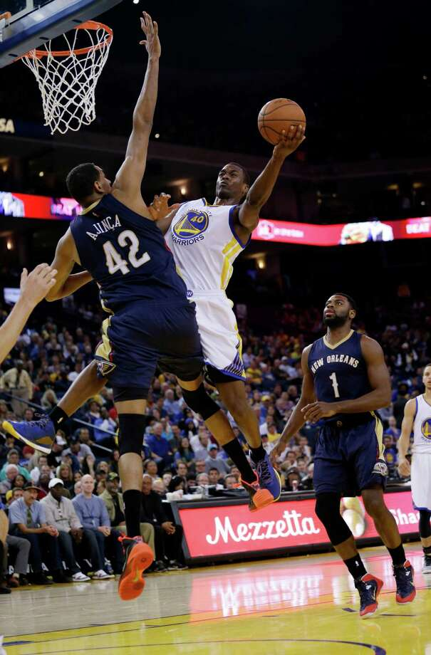 Golden State Warriors' Harrison Barnes (40) scores past New Orleans Pelicans' Alexis Ajinca (42) and Tyreke Evans (1) during the second half of an NBA basketball game Friday, March 20, 2015, in Oakland, Calif. (AP Photo/Marcio Jose Sanchez) Photo: Marcio Jose Sanchez / Associated Press / AP