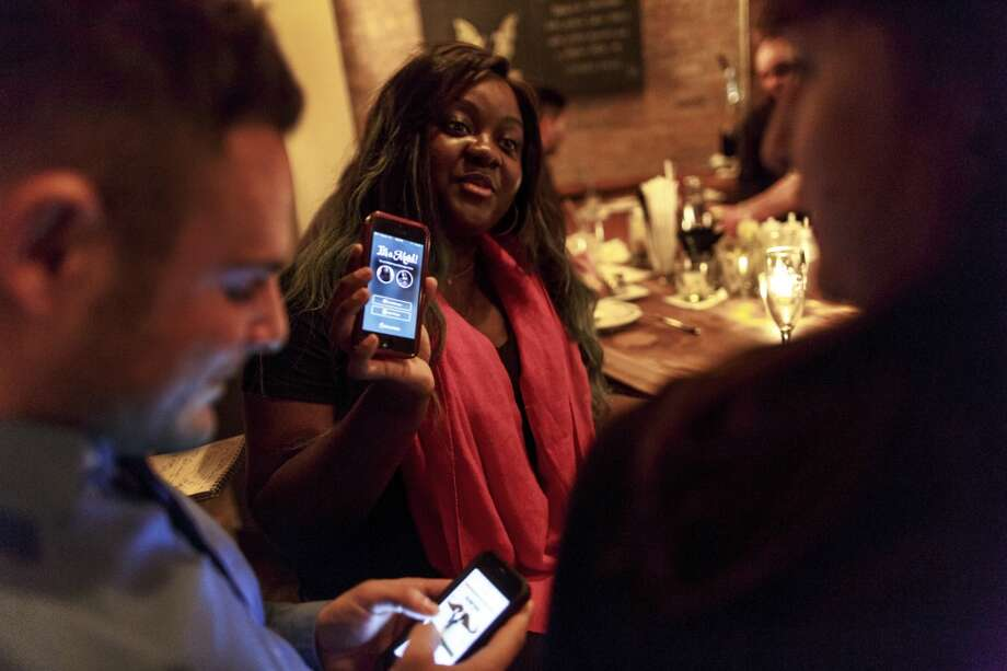 """Forget Tinder. At gentrified neighborhood bars everyone on an Internet date is using The League, the dating app for the """"elite."""" Photo: Richard Perry, New York Times"""