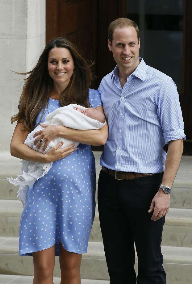 Prince William, right, and Kate, Duchess of Cambridge hold the Prince George of Cambridge as they pose for photographers outside St. Mary's Hospital in London a few days after the baby was born. Photo: Kirsty Wigglesworth, Associated Press