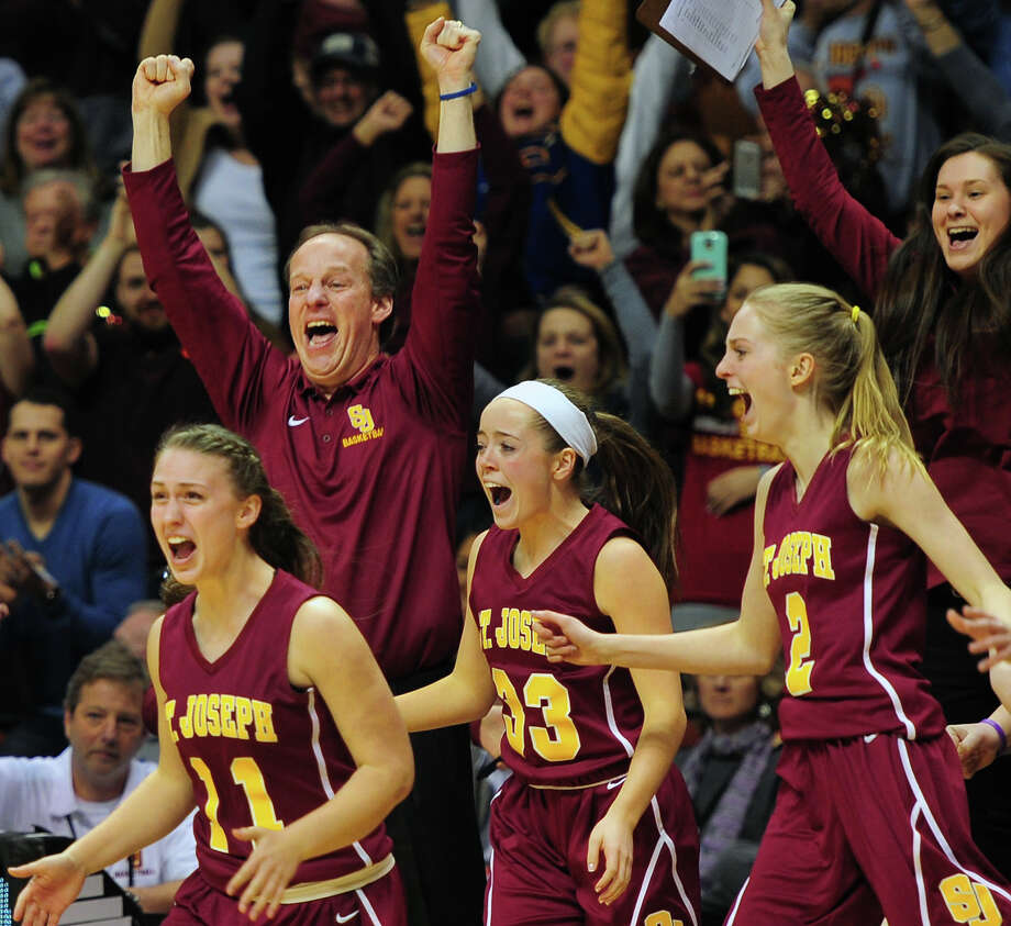 St. Joseph's coach Chris Lindwall and his team react as they beat Cromwell, during CIAC State Girls Basketball Tournament action at Mohegan Sun in Uncasville, Conn., on Saturday Mar. 21, 2015. Photo: Christian Abraham / Connecticut Post