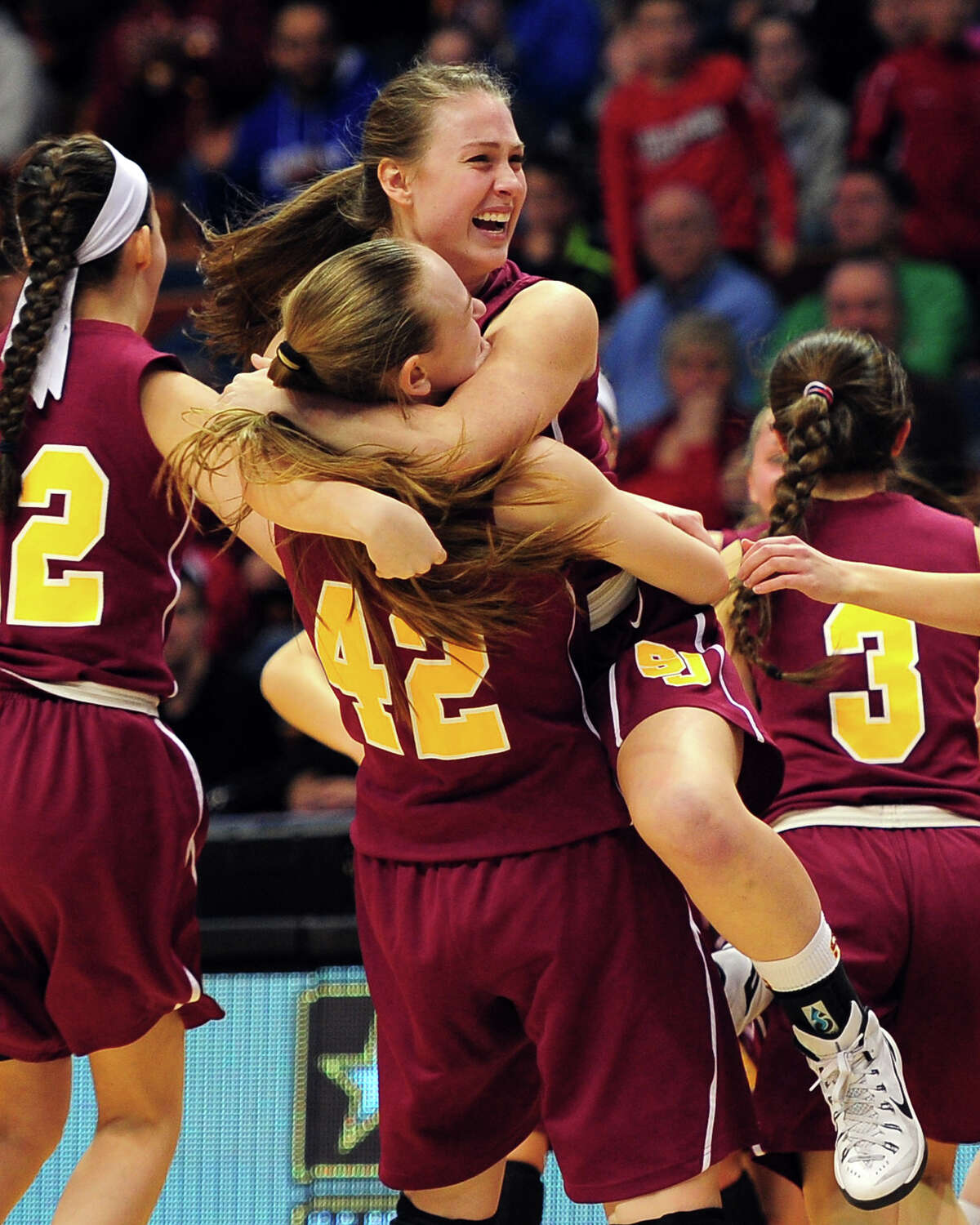 St. Joseph's Jacqueline Jozefick (42) and Erika Horvath hug as they celebrate beating Cromwell, during CIAC State Girls Basketball Tournament action at Mohegan Sun in Uncasville, Conn., on Saturday Mar. 21, 2015.