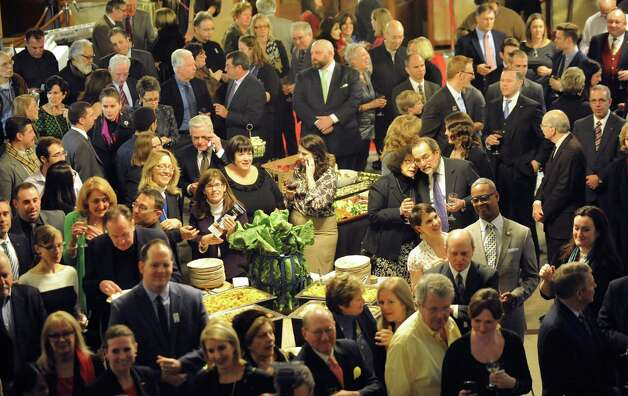 Attendees at the kick off of the 6th Anniversary Albany Chefs' Food & Wine Festival: Wine & Dine for the Arts on Thursday, Jan. 15, 2015, at City Hall in Albany, N.Y. This year's beneficiaries are the Albany Barn, Albany Institute of History & Art, Capital Repertory Theatre, The Palace Theatre and Park Playhouse. Events continue Friday and Saturday For more information visit http://www.albanywinefest.com. (Cindy Schultz / Times Union) Photo: Cindy Schultz / 00030228A