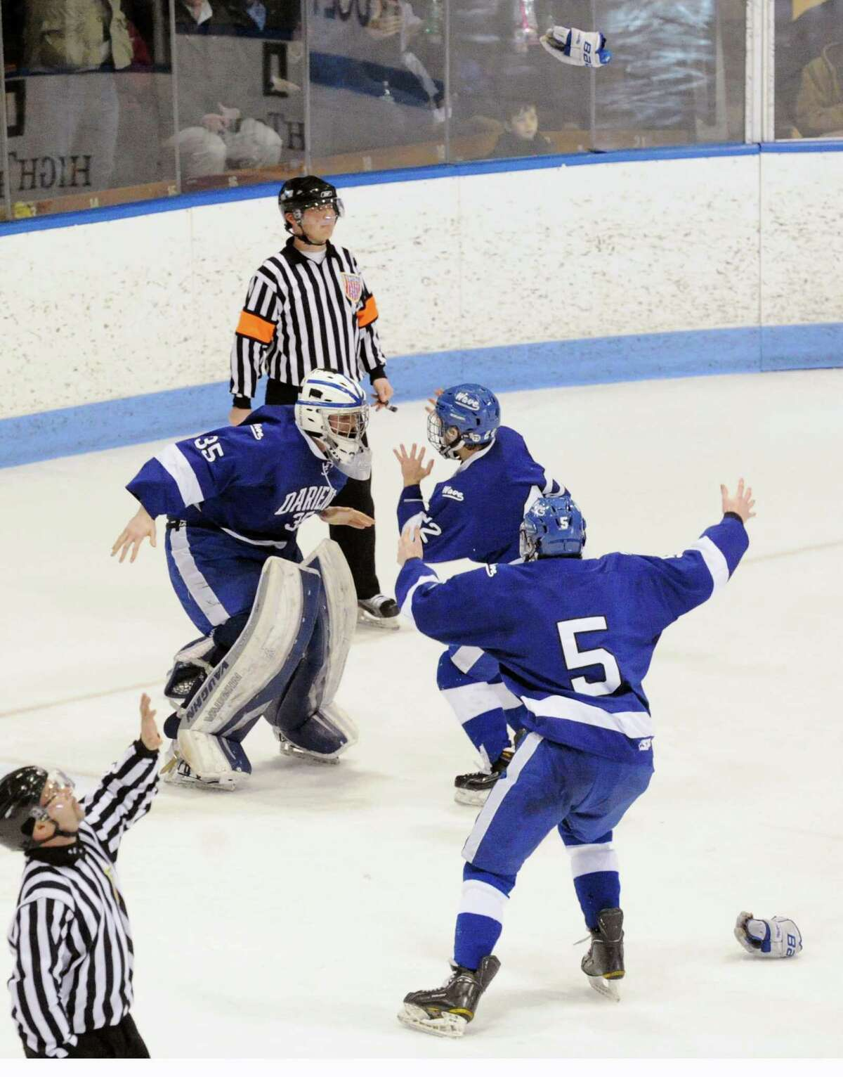 Darien goalie Will Massie, left, celebrates with teammates including Jake Kirby (#5), right, at the conclusion of the CIAC Division I boys state hockey championship game between Greenwich High School and Darien High School at Ingalls Rink in New Haven, Conn., Saturday March 21, 2015. Darien took the title with a 1-0 victory over Greenwich on a Jack Pardue goal in the second period.
