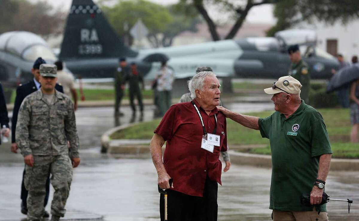 Air Force Col. (retired) Tom Collins, left, and Air Force Lt. Col. Alan Rose, both members of the Freedom Flyers, greet each other after a ceremony for POW that died in the Vietnam War at Joint Base San Antonio-Randolph Air Force. The group was there for their annual reunion. Friday, March 20, 2015.