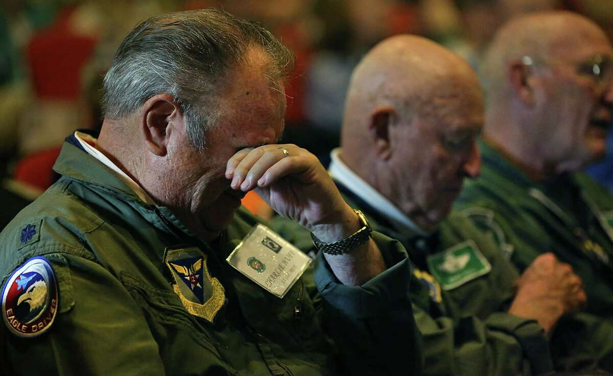 Lt Col (RET) Charlie Huff, left, is overcome with emotions as he listens to a story about how a fellow Air Force pilot was killed after being captured during the Vietnam War. Lt. Col (RET) John Yuill, center, a member of the Freedom Flyers from the Vietnam War, who was a POW for 6 years, sits next to him durring the group's annual reunion at Joint Base San Antonio-Randolph Air Force. Friday, March 20, 2015.