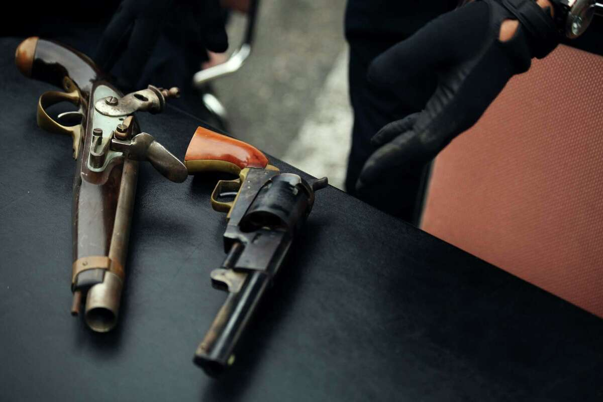 Antique guns brought to the gun buyback event at Ella Hill Hutch Community Center in San Francisco, Calif., Saturday March 21, 2015.