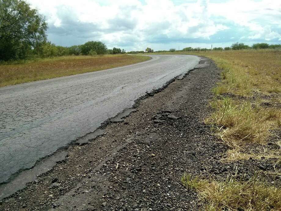 The 15.6-mile-long FM 469 in La Salle County is one of the roads damaged when oil field traffic increased. La Salle County has $94 million in tax-supported debt for things such as roads projects, according to the state comptroller. County Judge Joel Rodriguez said the idea was to pay for infrastructure through the bonds but to go on an aggressive payment schedule to get rid of the debt. Photo: Jennifer Hiller /San Antonio Express-News / San Antonio Express-News