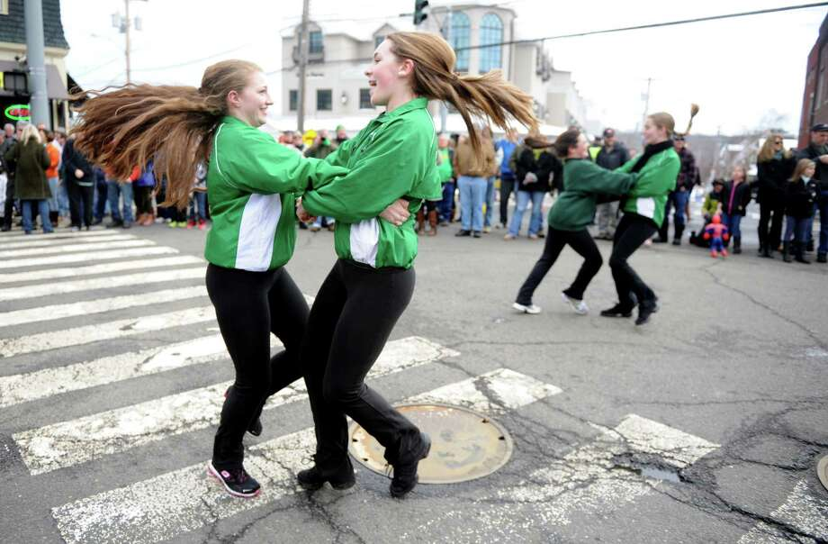 Kelly Scianna, 16, left, and Shannon Dolan, 15, both of Milford, perform with the Mulkerin School Of Irish Dance Saturday, Mar. 21, 2015 during the annual St. Patrick's Day Parade through downtown Milford, Conn. Photo: Autumn Driscoll / Connecticut Post