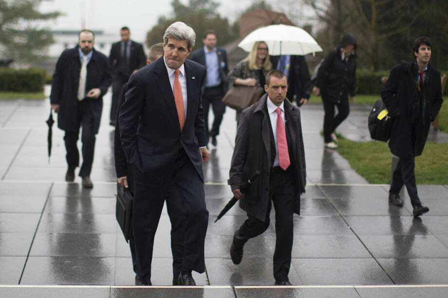 Secretary of State John Kerry arrives at the International Olympic Museum in Lausanne, Switzerland, where he delivered a statement regarding ongoing nuclear talks with Iran, March 21, 2015. Kerry said negotiators should stick to their goal of completing an initial accord by the end of March. (Brian Snyder//Pool via The New York Times) -- FOR EDITORIAL USE ONLY. ORG XMIT: XNYT6 Photo: BRIAN SNYDER / POOL