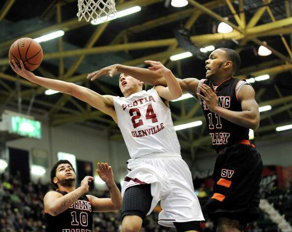 Scotia's Joe Cremo, center, goes to the hop as Spring Valley's Jordan Duncan defends during their Class A State boys basketball semifinal on Saturday, March 21, 2015, at Glens Falls Civic Center in Glens Falls, N.Y. (Cindy Schultz / Times Union) Photo: Cindy Schultz / 10031108A