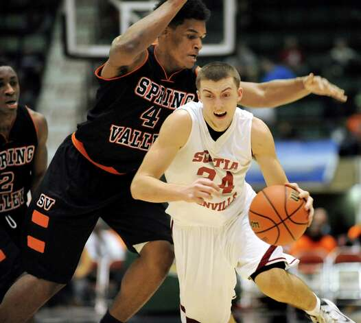 Scotia's Joe Cremo, center, drives to the hoop as Spring Valley's Kai Mitchell defends during their Class A State boys basketball semifinal on Saturday, March 21, 2015, at Glens Falls Civic Center in Glens Falls, N.Y. (Cindy Schultz / Times Union) Photo: Cindy Schultz / 10031108A