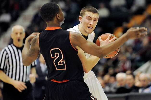 Scotia's Joe Cremo, right, looks for room as Spring Valley's Rickey McGill defends during their Class A State boys basketball semifinal on Saturday, March 21, 2015, at Glens Falls Civic Center in Glens Falls, N.Y. (Cindy Schultz / Times Union) Photo: Cindy Schultz / 10031108A