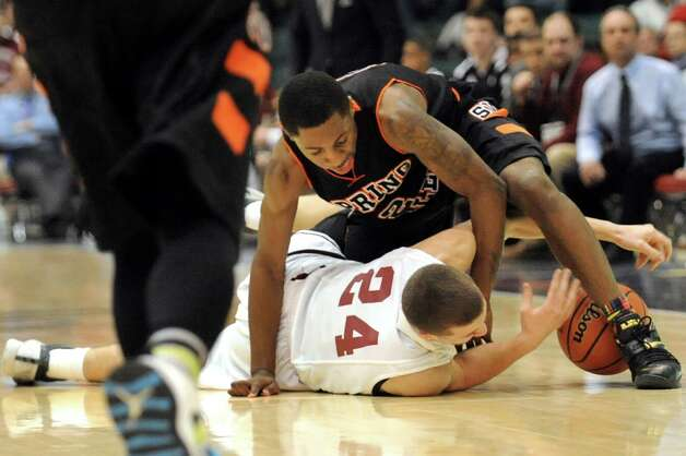 Scotia's Joe Cremo, center, scrambles for a loose ball with Spring Valley's Rickey McGill during their Class A State boys basketball semifinal on Saturday, March 21, 2015, at Glens Falls Civic Center in Glens Falls, N.Y. (Cindy Schultz / Times Union) Photo: Cindy Schultz / 10031108A