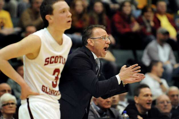Scotia's coach Jim Giammattei, right, disputes a call during their Class A State boys basketball semifinal against Spring Valley on Saturday, March 21, 2015, at Glens Falls Civic Center in Glens Falls, N.Y. At left is Scott Stopera. (Cindy Schultz / Times Union) Photo: Cindy Schultz / 10031108A