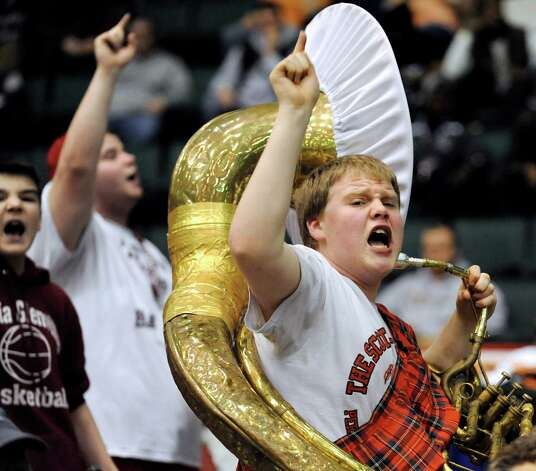 Band leader Kyle Yagielski, 17, right, joins the Scotia-Glenville Perfect Pitch Precision Pep Band as they cheer on their team in the Class A State boys basketball semifinal against Spring Valley on Saturday, March 21, 2015, at Glens Falls Civic Center in Glens Falls, N.Y. (Cindy Schultz / Times Union) Photo: Cindy Schultz / 10031108A