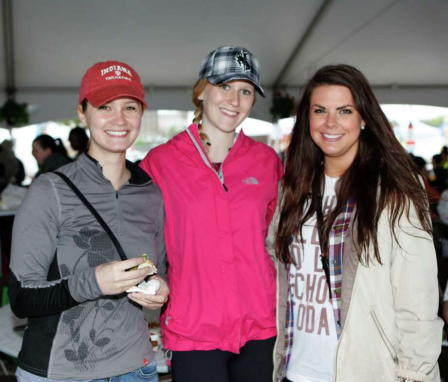 Guests pose for a photo at the Haute Wheels Houston food truck festival at Houston Community College West Loop Campus Saturday, March 21, 2015, in Houston. Photo: Jon Shapley, Houston Chronicle / © 2015 Houston Chronicle