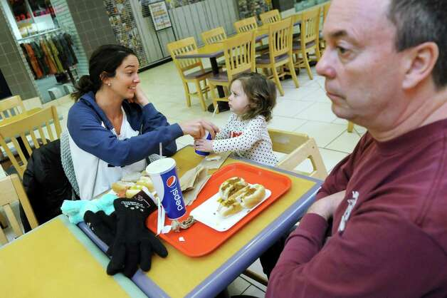 Molly McDonaugh of Lansingburgh, left, her niece Hallie McGrath, 20 months, and father Tim McDonaugh have lunch at the food court on Wednesday, March 4, 2015, at Clifton Park Center in Clifton Park, N.Y. (Cindy Schultz / Times Union) Photo: Cindy Schultz / 00030833A