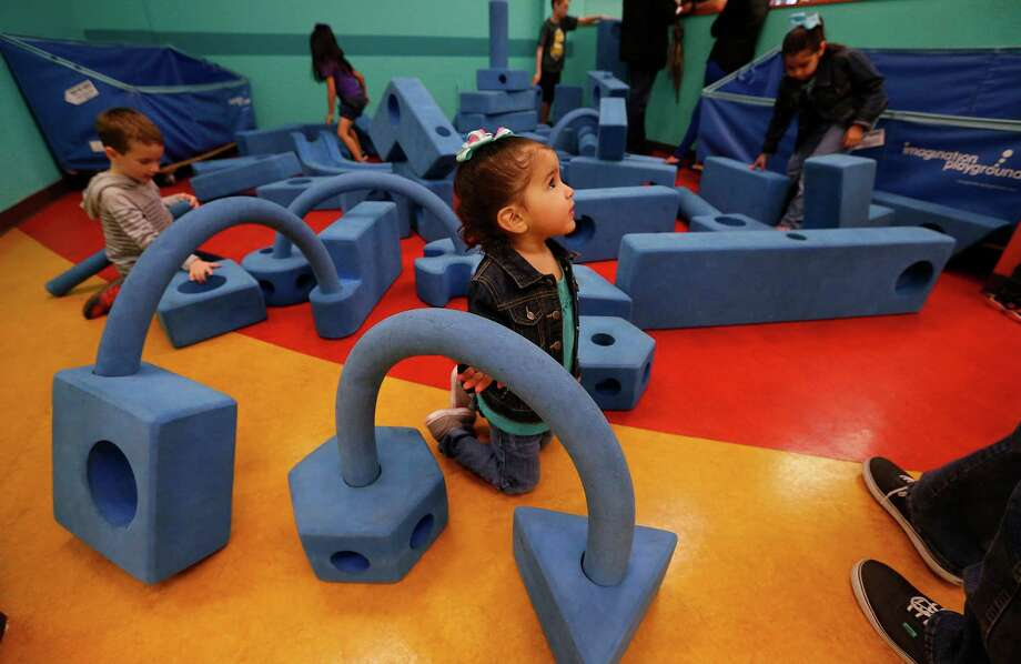 Klorissa Trevino, 3, plays with building blocks in the Imagination Playground at the San Antonio Children's Museum on Houston Street, which celebrated its 20th anniversary Saturday. Photo: Kin Man Hui /San Antonio Express-News / ©2015 San Antonio Express-News