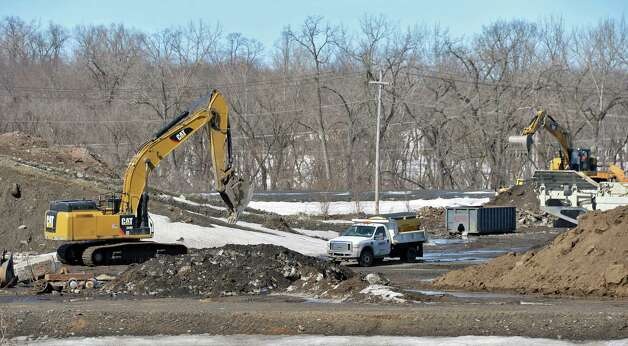 Heavy equipment at the future casino site Thursday March 12, 2015 in Schenectady, NY.  The land is declared tax exempt, and a $40,000 payment in lieu of taxes is paid to cover the entire 53-plus acre site. (John Carl D'Annibale / Times Union) Photo: John Carl D'Annibale / 00030980A