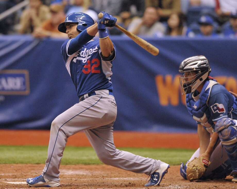Los Angeles Dodgers catcher Tyler Ogle, who attended Canyon High School in New Braunfels, hits a single during Major League Weekend baseball action in the Alamodome against the Texas Rangers on Saturday, March 21, 2015. Photo: Billy Calzada, Staff / San Antonio Express-News / San Antonio Express-News