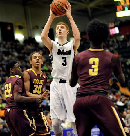 Shen's Kevin Huerter, center, shoots for the hoop during their Class AA State boys basketball semifinal against Mount Vernon on Saturday, March 21, 2015, at Glens Falls Civic Center in Glens Falls, N.Y. (Cindy Schultz / Times Union) Photo: Cindy Schultz / 10031109A